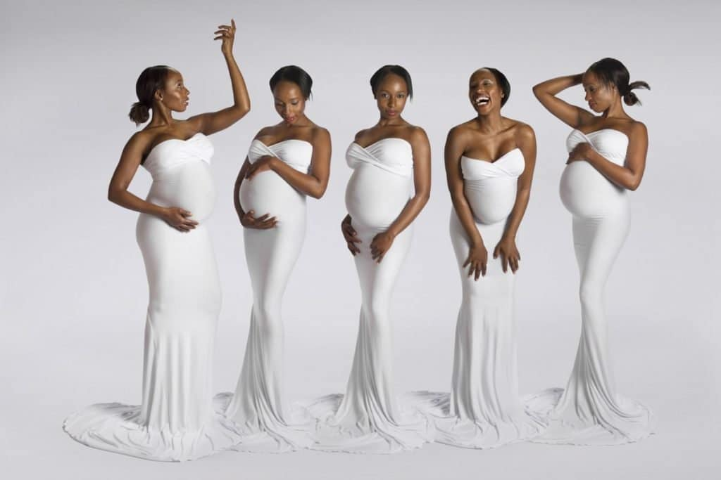 Beautiful pregnancy photograph of woman in white dress