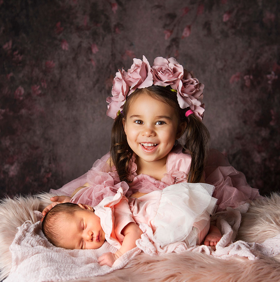 pretty in pink, big and little sisters in the studio, toddler and newborn