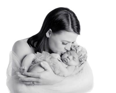 include yourself in photos, soft high key black and white of newborn and mum wrapped in tulle