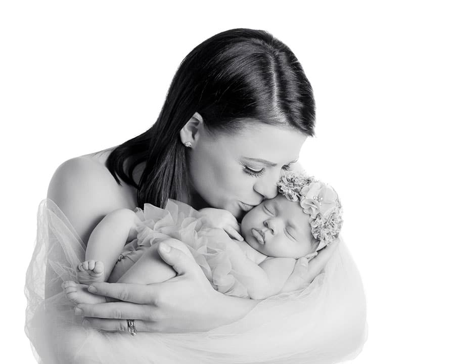 soft high key black and white of newborn and mum wrapped in tulle, studio Northcote
